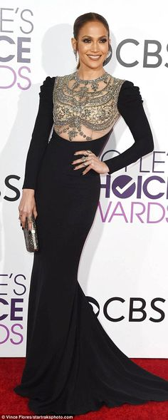 Show-stopper: The 47-year-old pop icon looked amazing in the garment which clung to every curve and featured a sheer cut-out on the bodice