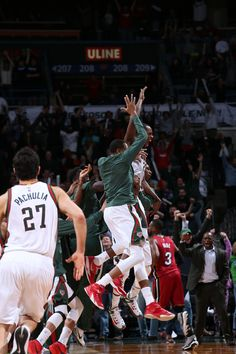 Khris Middleton  22 of the Milwaukee Bucks celebrate after winning the game  against the Miami b6e503e7a