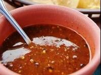Salsa Roja (El Salvadorean pupusa sauce). Don't use the chilis, though as the sauce is NOT spicy traditionally.
