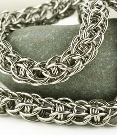Stainless steel necklace by silverfalls. Captive rings within Full Persian.