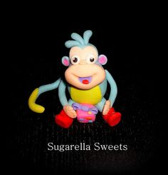 Sugarella Sweets: How to make Boots from Dora cake topper