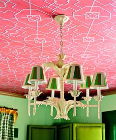 pink papered ceiling and green walls, a brave choice with grand results