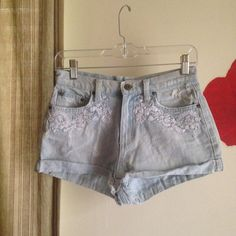 Jean high waisted shorts Light Jean high waisted shorts with white floral embroidery on front and distressed details // worn but still cute Shorts