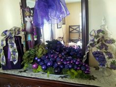 Grapes made with purple ornaments (I would use wine & deeper purple for family room fireplace)