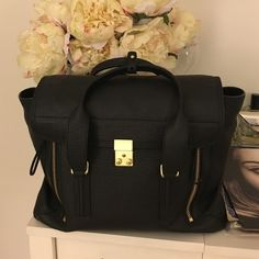 3.1 Phillip Lim Large New pashli Black Satchel Brand new black pashli 3.1 Phillip lim - never used -comes with strap and dust bag- large size satchel- authentic! Willing to trade for another bag 3.1 Phillip Lim Bags Satchels