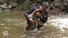 Brave explorer Cemal Gulas cuddles up to a bear after they enjoy a playful water fight at the end of a waterfall in new Junkin video