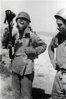 An Italian army sapper assigned to the flame-thrower wearing a gas mask and a uniform of asbestos. August 1941 - pin by Paolo Marzioli