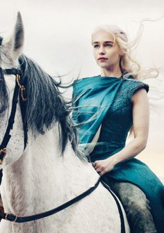 The Khaleesi sits still and straight on her silver mare, surveying her troops