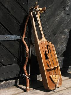 Jouhikko | a bowed lyre, related to welsh crwth and swedish talharpa, amongst others. A bowed lyre of ancient Finnish origin, related to similar northern European instruments.     Body is oak, soundboard heat processed birch, bridge, the string extension piece and the neck reinforcement are ash, and the tuning pegs are beech. Strings are made of horsehair.