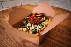 Poutine drizzled with hummus, tabbouleh, fried carrots, aioli and shredded halloumi from Rose City Kitchen. Rose City, Poutine, Halloumi, Great Restaurants, Aioli, Healthy Alternatives, City Life, Hummus, Food To Make