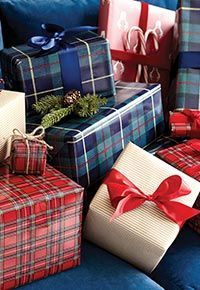 Suzanne Kasler designed this classic Mackenzie plaid ribbon in two colors to tie a bow on this holiday season with timeless British style. Shop Ballard Designs.