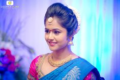 South Indian bride. Temple jewelry. Jhumkis. Blue silk kanchipuram sari.Bun with fresh jasmine flowers. Tamil bride. Telugu bride. Kannada bride. Hindu bride. Malayalee bride.Kerala bride.South Indian wedding