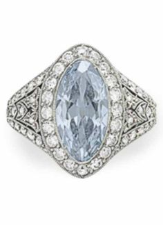 A BELLE ÉPOQUE COLOURED DIAMOND AND DIAMOND RING, BY J.E. CALDWELL. Set with a marquise brilliant-cut fancy to fancy intense blue diamond, to the circular and old-cut diamond surround, pierced gallery and shoulders, circa 1915, mounted in platinum Signed J.E.C Co. for J.E. Caldwell, numbered. #Caldwell #BelleEpoque #ring