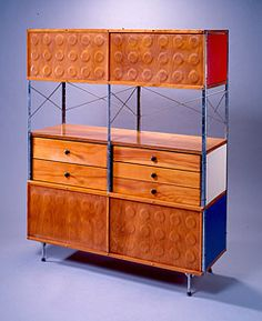 Artist Name: Charles Eames  Nationality & Life Dates: American, 1907–1978  Title: Eames Storage Unit (ESU)  Date: 1953-1955  Medium: Molded plywood, zinc-plated steel, and laminated Masonite  Dimensions: 58 5/8 x 47 x 16 3/4 inches  Credit Line: Purchase with funds from the Decorative Arts Endowment  Accession Number: 1999.121