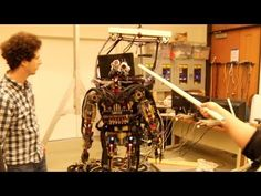 The Sarcos Robot is back in this new video from June 2013. Eric Whitman explains more about the robot's abilities and sensors and then goes on to push it around... With a big, white stick.