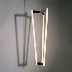 Tube Chandelier is a simple geometric piece, perfect in any room of your home. Available with mouth blown Opal glass diffusers and finished in Black Patina, Satin Brass or Special Edition White. Black Chandelier, Vintage Chandelier, Chandelier Pendant Lights, Art Et Design, Lamp Design, Lighting Showroom, Interior Lighting, Architecture Restaurant, Linear Lighting