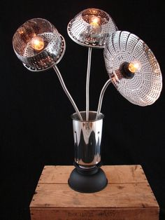 ... because we've all gone through more of these than we should have. A pretty and plesant alternative to the trash.    Upcycled Lamp with Blooming Kitchen Steamer by BenclifDesigns, $185.00