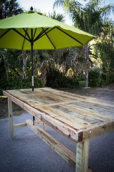 "Outdoor Umbrella Table Pub style from Reclaimed Pallet Wood 42""W x 8'L  x 42""H on Etsy, £442.40"