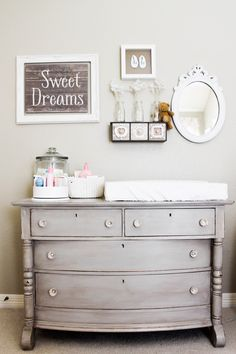 Organized, functional and beautifully designed changing table in a vintage nursery!