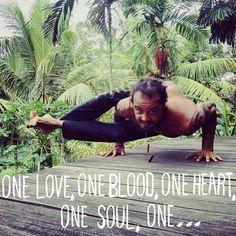 Michael Franti in Astavakrasana (Eight Angle Pose)…one love