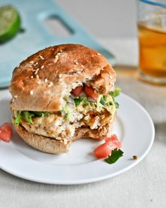 tilapia burgers w/watermelon salsa & avocado. Yum. Definitely subbing mahi or another firm fish...i don't eat those poop-eaters [tilapia]