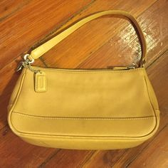 Coach tan mini shoulder bag Coach authentic bag with pretty tan leather and high quality stitching. Inside is in perfect condition. Outside is gently used with one smudge as pictured, which is not noticeable at all when worn. Coach Bags Mini Bags
