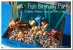 Fish Birthday Party Ideas - Such a cute glass with EDIBLE glass aquarium. Plus love the decorations and super cute party games