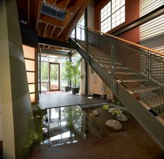 Indoor Ponds under the Stairs: Amusing Azdarch Indoor Water Feature Pond Below Stairs With Glass Floor Design Ideas Also Steel Frame And A Fenced Shaped Nets Along With Glass Door Indoor Plants On Pots ~ wiligear.com Interior Design Inspiration