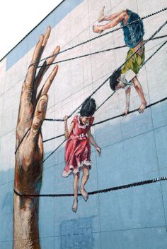 After his recent trip in Italy (covered), Ernest Zacharevic was recently in Lithuania where he spent a few days working on this new piece in Vilnius. In town for the Vilnius Street Art Festival, the young artist painted some of his signature playful imagery with this mural showing a bunch of kids playing rope games.