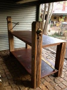 Rustic industrial island bench or retail counter. Handcrafted using reclaimed roofing iron and ironbark electrical posts from Ballarat.