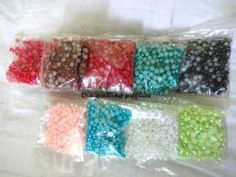 Half color pearls  Rs 15/packet  8 colors available  Buy any 8 colors @ Rs 110
