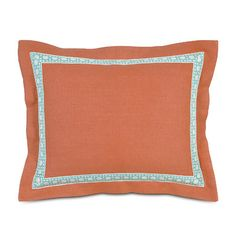 A coral sham livens up bedding with a hit of color. | $200