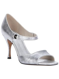 Silver-tone leather sandal from Marc Jacobs featuring a wide strap at the toe, a metallic button and tab fastening at the ankle, a leather covered stiletto heel and a leather sole.