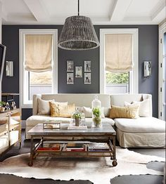 5 Ways to Layer Neutrals Love the deep blue wall color next to the white trim.