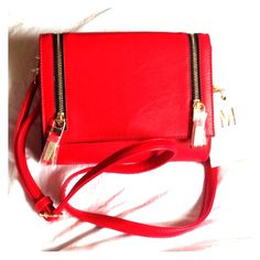 Beautiful red handbag! Vibrant red bag with stylish zippers! Can be dressed up or down and carried several ways. Brand new! Miztique Designer Collection  Bags