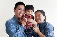family of three, mom dad and baby, first birthday photos, one year old photos, smiling baby, natural light photo studio © Dimery Photography 2013