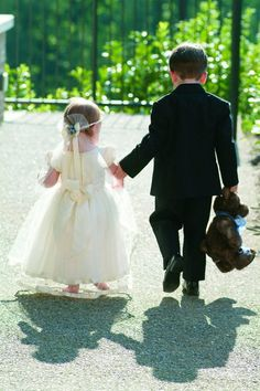 the cutest flowergirl and ring bearer heading down to the ceremony
