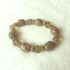 Stone bracelet Olive green stone, rhinestone and beaded bracelet on stretchy string. American Eagle Outfitters Jewelry Bracelets
