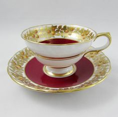 Made by Grosvenor, tea cup and saucer are red with gold leaves. Gold trimming on the cup and saucer edges. Excellent condition (see photos). Markings read: Grosvenor Bone China England Please bear in mind that these are vintage items and there may be small imperfections from age or