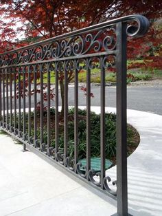 Jozef Custom Ironworks | Iron, Bronze, Curved Stair Railings, Spirals, Gates, Forged bronze railing with beautiful scrolls and top trim. Patina finish. Huntington, Long Island.