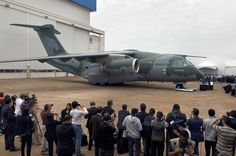 The new Embraer KC-390 aircraft is seen at a roll-out ceremony at Embraer's production facilities in Gaviao Peixoto, Brazil, on October 21, 2014 (AFP Photo/Nelson Almeida)