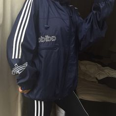 Rare navy adidas originals windbreaker With hood great vintage condition ❤️ All items bought ships the same day or the next day at the latest. ❤️ Make an offer through the offer button only please ❤️ All items are in great like new condition unless stated otherwise. ❌ No trades and I only sell on poshmark Adidas Jackets & Coats