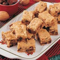 Chewy Date Nut Bars Recipe -You'll need just six ingredients, including a convenient boxed cake mix, to bake up these chewy bars chock-full of walnuts and dates. They are my husband's favorite snack, and he loves to take them to work. I often whip up a batch for bake sales or to share with my co-workers at our local car dealership.