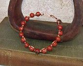 amber bead and copper bracelet