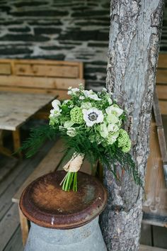 All white wedding bouquet with lush green foliage. Photography by www.emmacasephotography.com