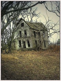 Abandoned and leaning, a tired empty home slowly falling to the ground.