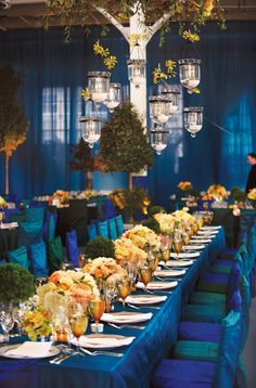 love the blue tones with a pop of yellow and orange, also like the hanging lanterns