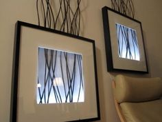 Ikea product based decorative wall decor including branches, frame and lighting