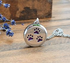 Celebrate your love of dogs or cats at the same time that you breathe in your favorite scent all day with this paw print essential oil diffuser necklace. This diffuser locket is the perfect pet jewelry perfect for any cat or dog lover. Specifications: The pendant is 30mm and has a strong magnetic closure. It will not open accidentally on you. You can use a felt or leather insert. You will receive three felt pads with each locket. The chain is a stainless steel rolo locket chain. You can…