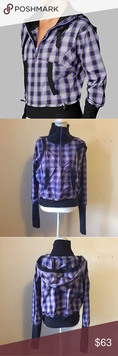 Lululemon Run Reflection Pullover Hoodie 10 Lululemon Run Reflection pullover hoodie in purple plaid print. Kangaroo pocket in front. Ribbed lower sleeves with thumbholes. Hole for ponytail in the hood. Drawstrings at waist. Size 10. Excellent condition! lululemon athletica Jackets & Coats